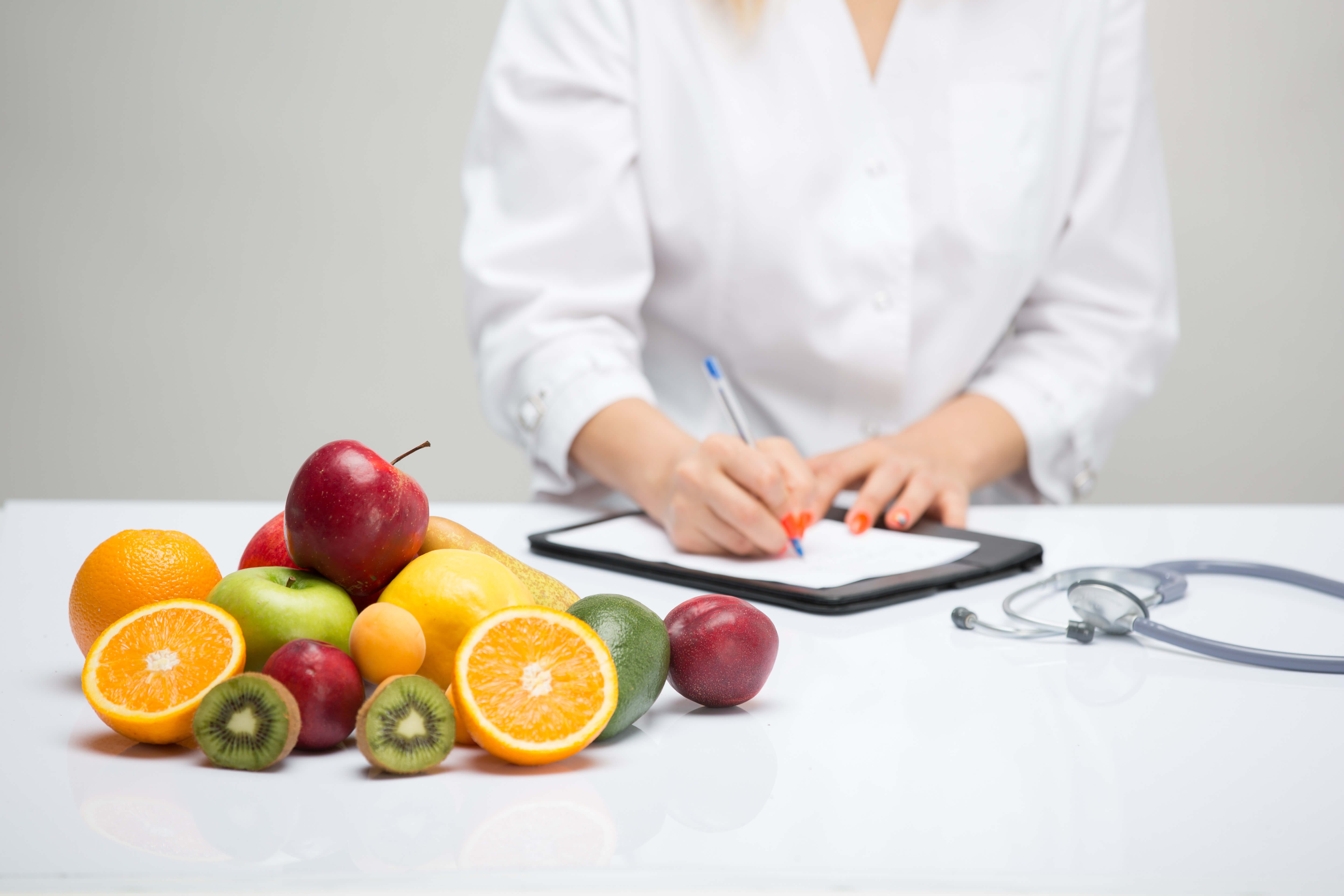 Healthy life style concept, doctor writing, diet and losing weight